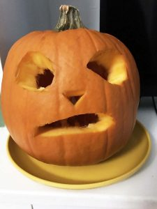 carved pumpkin on yellow plate