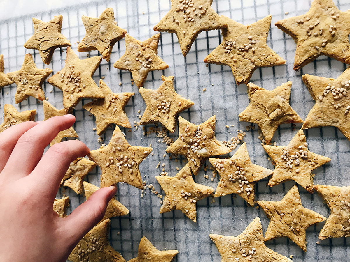 Star shaped oatcakes with child's hand in shot