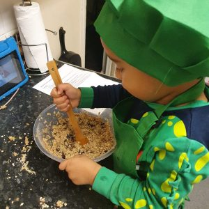 mini chefs - boy stirring flapjack mixture