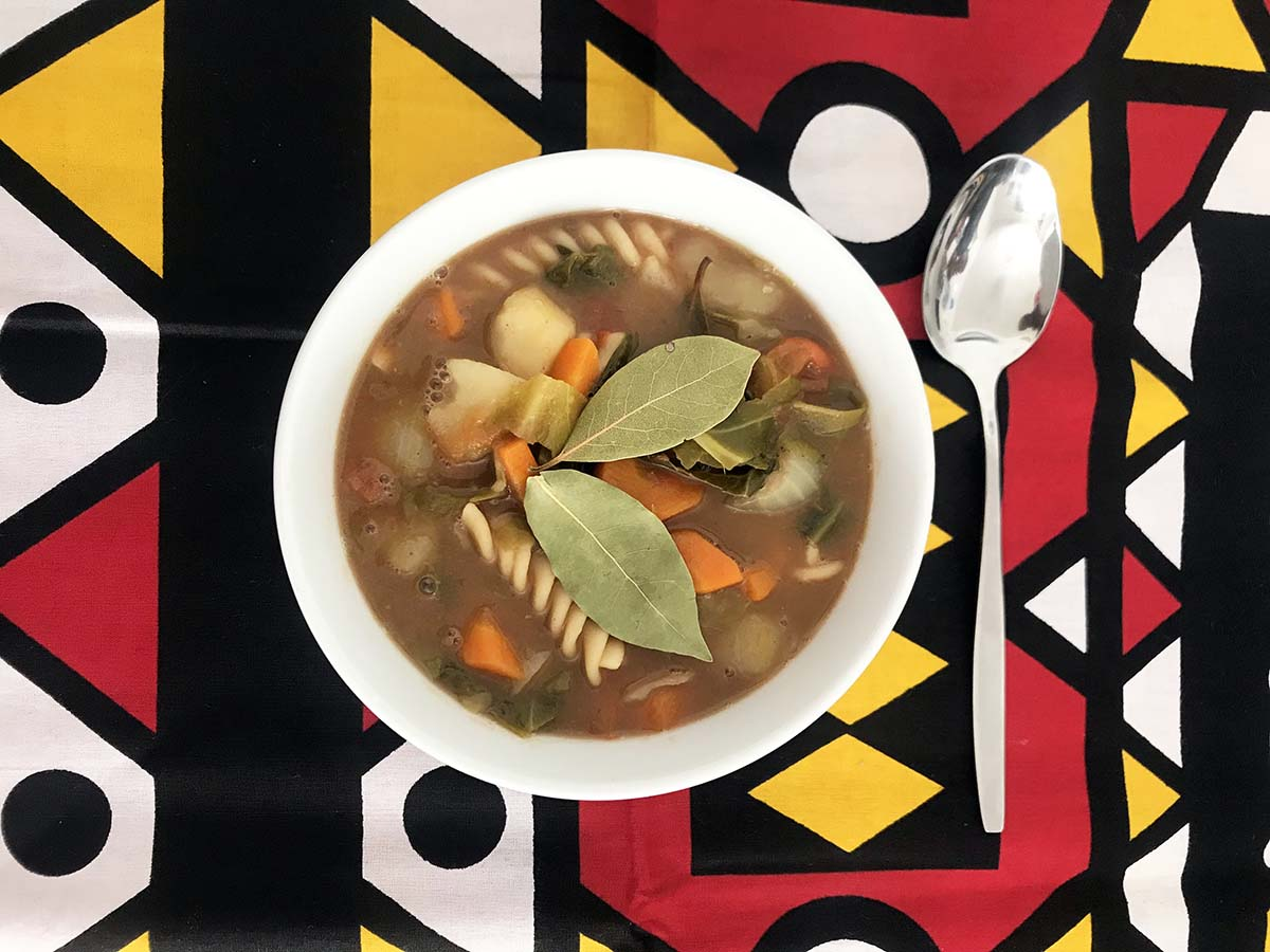 Angolan bean soup on colourful background